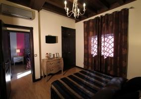 Dormitorio y ventanales