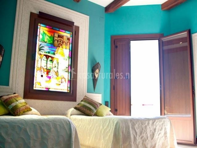 Dormitorio Córdoba con vidriera