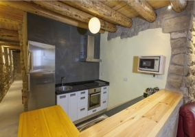 Kitchen with two countertops (one wooden) and appliances