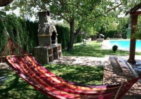 Barbacoa y Tumbona en la Terraza