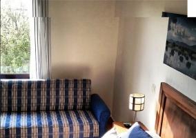 Habitación doble con camas individuales y con sofá-cama