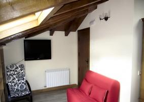 Zona de estar del dormitorio del ático