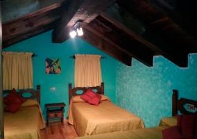Dormitorio de tres camas