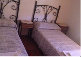 Dos camas individuales de la casa rural