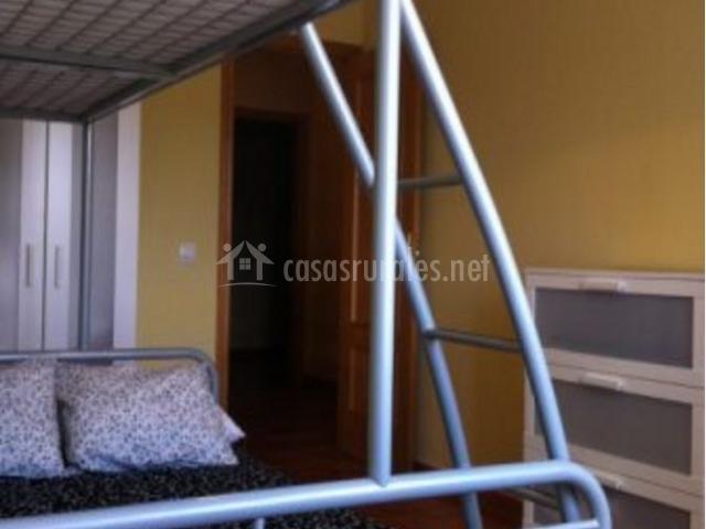 Dormitorio triple con litera