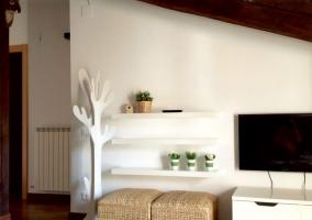 A Sala de estar y cocina en el mismo espacio