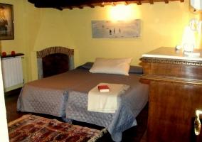 Dormitorio dobles colchas azules