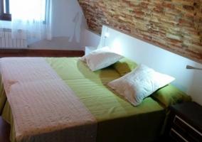 Dormitorio doble con colchas en color verde