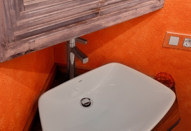 Toilet with orange walls
